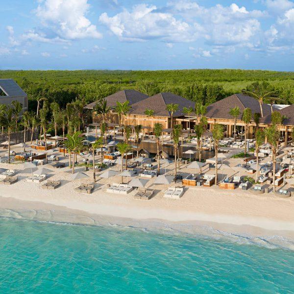 beach club cabanas line white-san beach on caribbean ocean