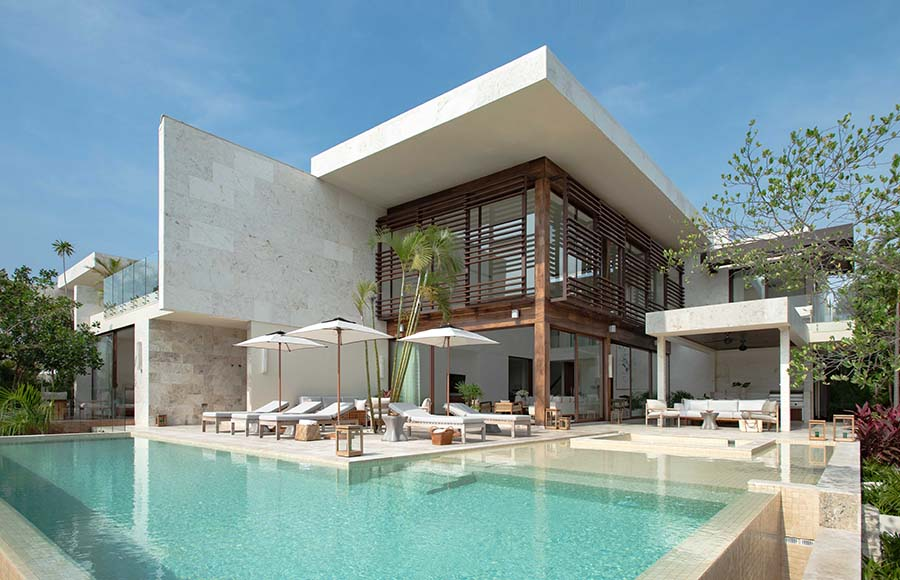 villa terrace with large waterfront pool